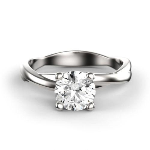 Помолвочное кольцо из платины с бриллиантом и знаком бесконечности