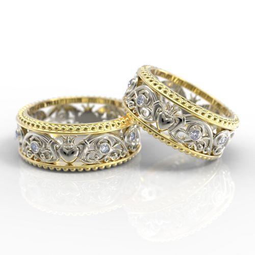 """Обручальные кольца с """"кладдахской"""" символикой и рельефным орнаментом из желтого золота"""