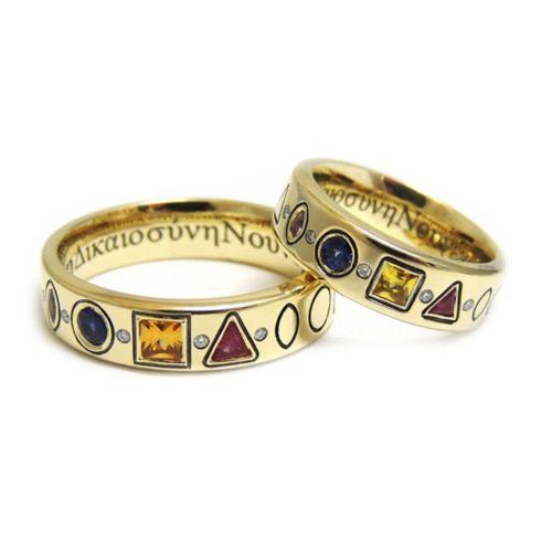 Обручальные кольца интересного дизайна с разноцветными сапфирами разной формы