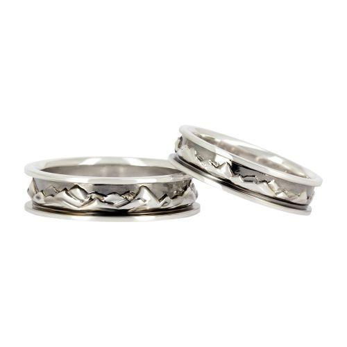 Обручальные кольца из белого золота с объемным узором