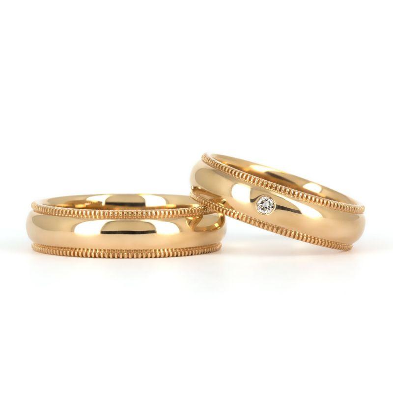 Кольца из красного золота с насечками по краям