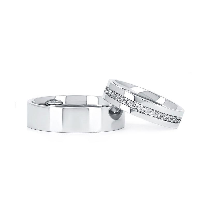 Классические обручальные кольца из платины с бриллиантами