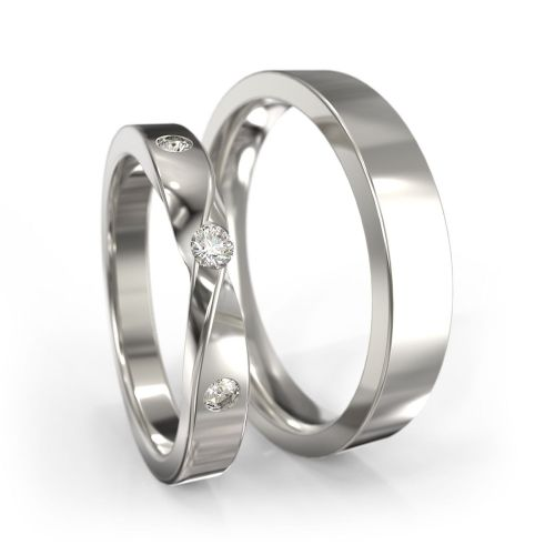 Обручальные кольца из красного золота с символом бесконечности на кольце невесты