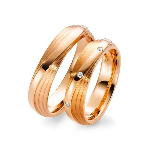 Парные обручальные кольца из красного золота с бриллиантами оригинальной формы