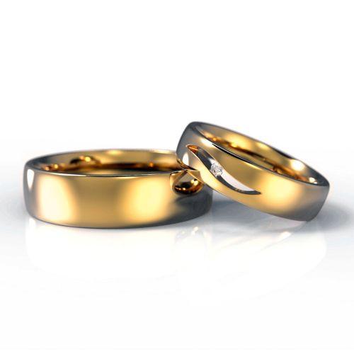 Обручальные кольца из красного золота с бриллиантом