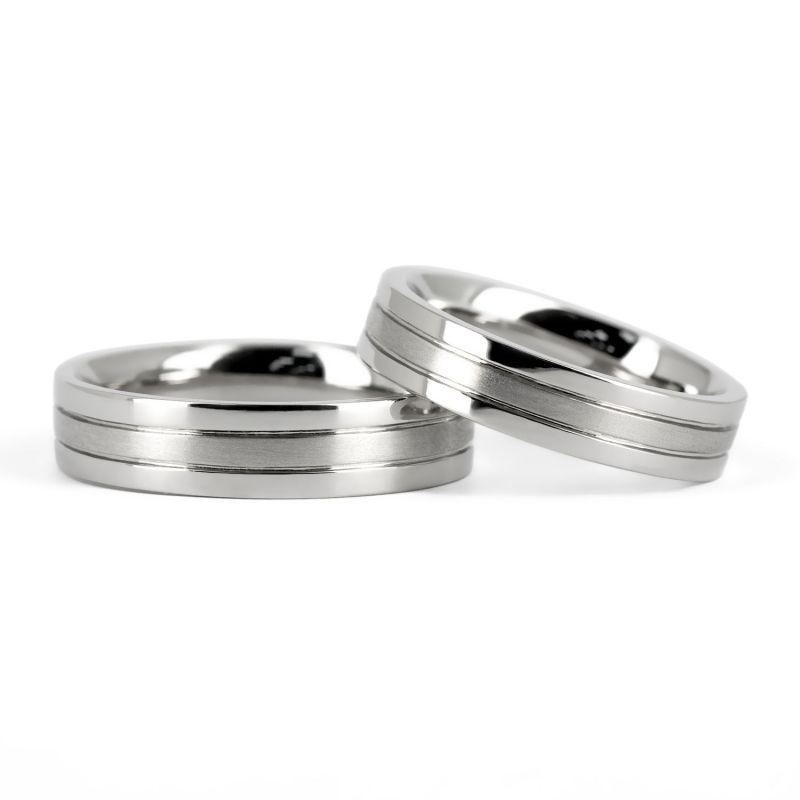 Стильные обручальные кольца парные из белого золота