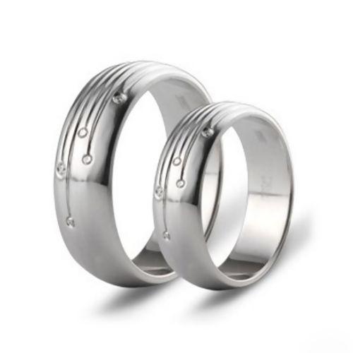 Обручальные кольца парные из белого золота с бриллиантами