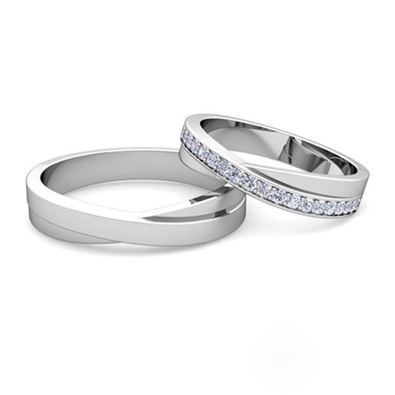 Обручальные кольца «Бесконечность» с бриллиантами из белого золота
