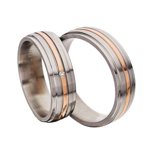 Обручальные кольца с бриллиантом из белого и красного золота