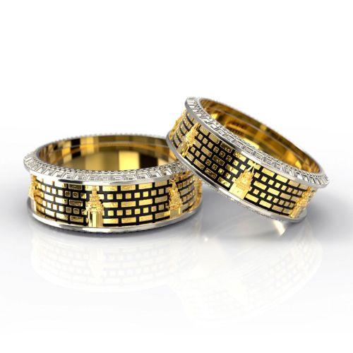 Обручальные кольца с объемными кремлёвскими башнями из комбинированного золота с чернением
